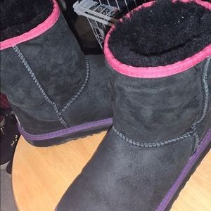 little girls pink, purple, and black uggs